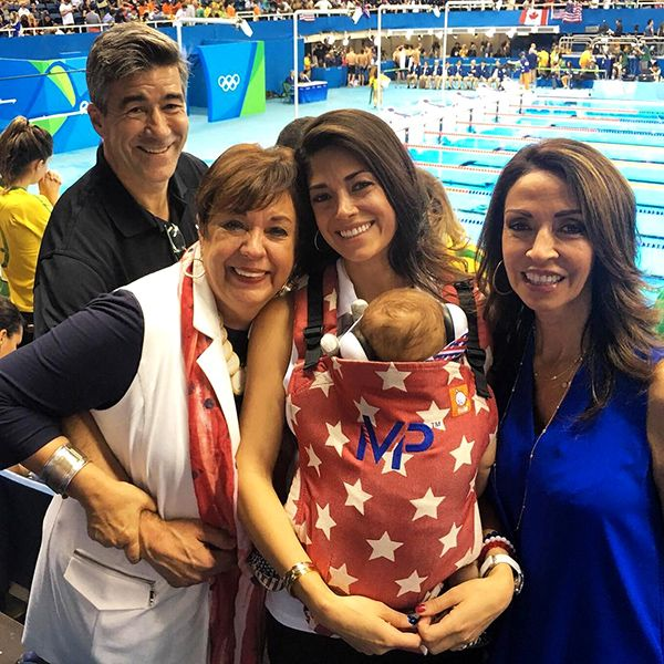 Nicole Johnson Celebrates Michael Phelps' Final Swim with Baby Boomer and Parents
