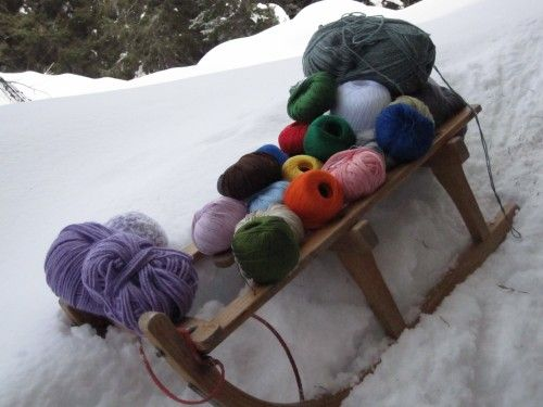 Antique sleigh and balls of wool