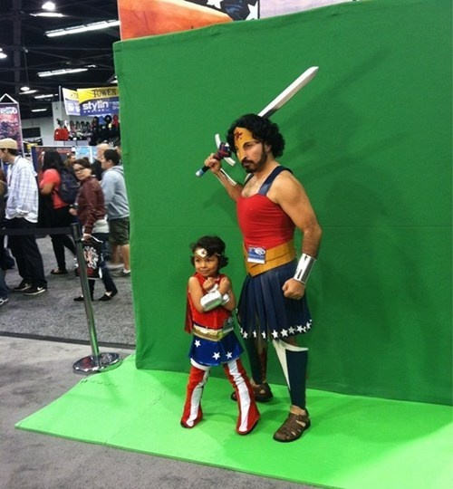 Father - daughter Wonder Woman cosplay at Wondercon 2013. I love how he has managed to make his costume look like some gladiator/WonderWoman mashup and hasn't gone for 'comedy man in a dress' look. And i love the wee girl's posing.