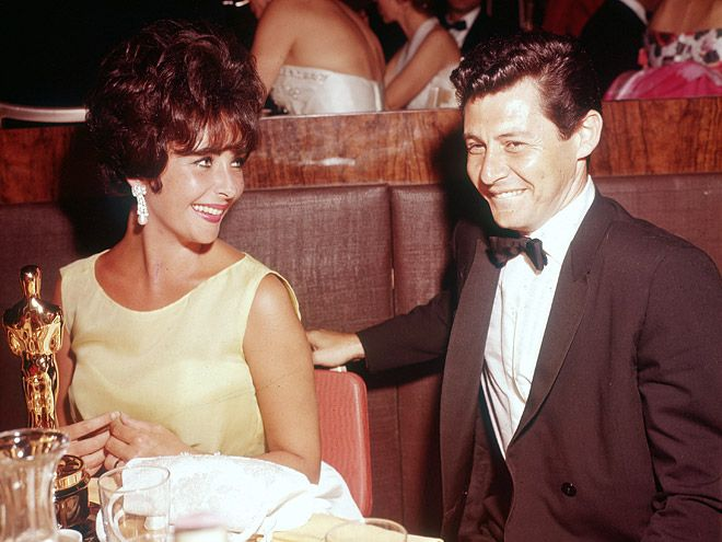 20 Incredibly Classy Vintage Pics of Academy Awards Winners Past | ELIZABETH TAYLOR | Taylor and her then-husband, Eddie Fisher, celebrate Taylor's Best Actress win for Butterfield 8 in 1960.