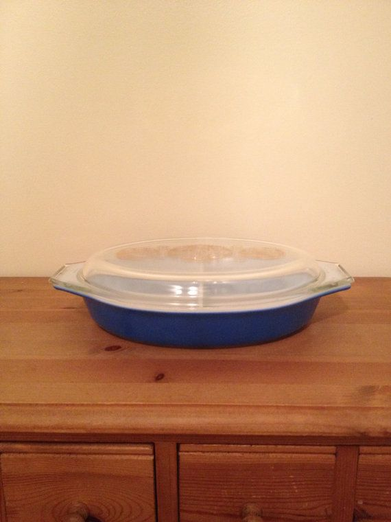 cVintage Pyrex Gold Medallion Oval 1 1/2 Quart Casserole with Decorative Lid. This was a 1961 Promotional Casserole. It has the gold medallions on the clear glass lid. The bottom casserole is a royal blue. This is a great casserole for your Pyrex collection! Measures: 12 3/4 handle