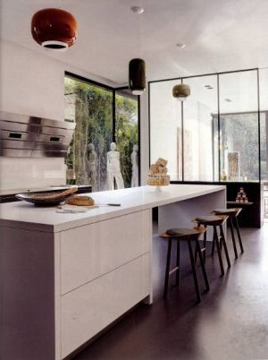 modernist kitchen with AEG vertical vent hood - Elledecor via Atticmag by Allison Shops