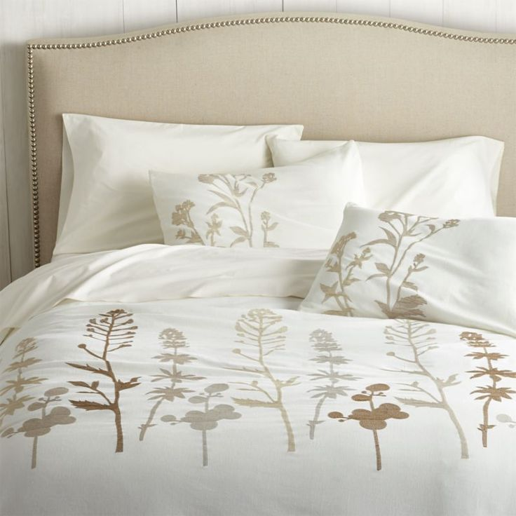 Shop Woodland Natural Duvet Covers and Pillow Shams.  Woodland plants blanket cotton-linen fabric in a forest of embroidered silhouettes, taking shape in a range of soft neutrals on ivory.