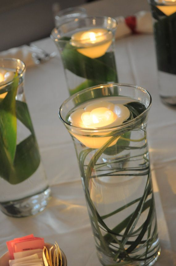 Great idea, and could be done for much cheaper as DIY.  Love this for centerpieces.