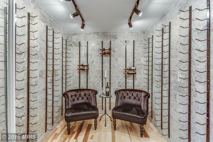Eclectic Wine Cellar with flush light, 18 Bottle Epic Metal Wine Rack, Hardwood floors, High ceiling