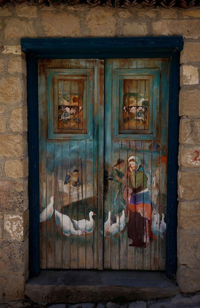 Painted wood hotel door in Turkey. - by Ekrem Nuray