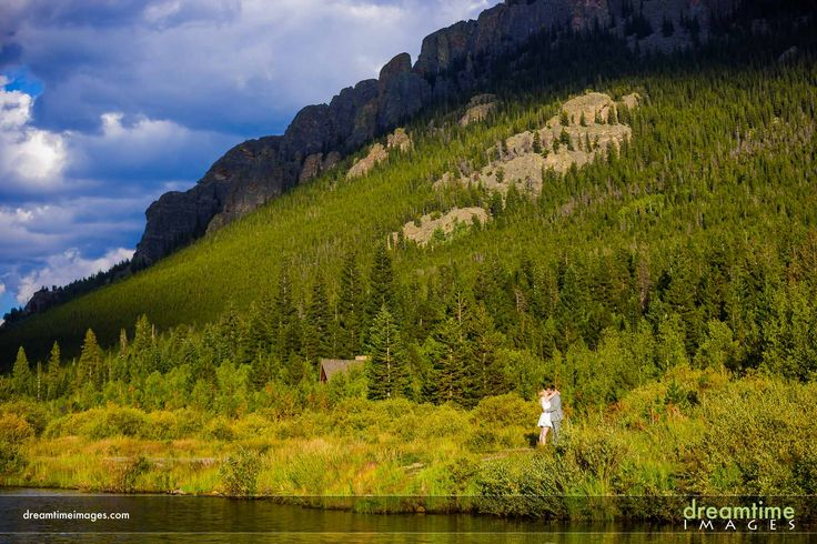 A wedding elopement portrait on the edge of Lily Lake in Estes Park