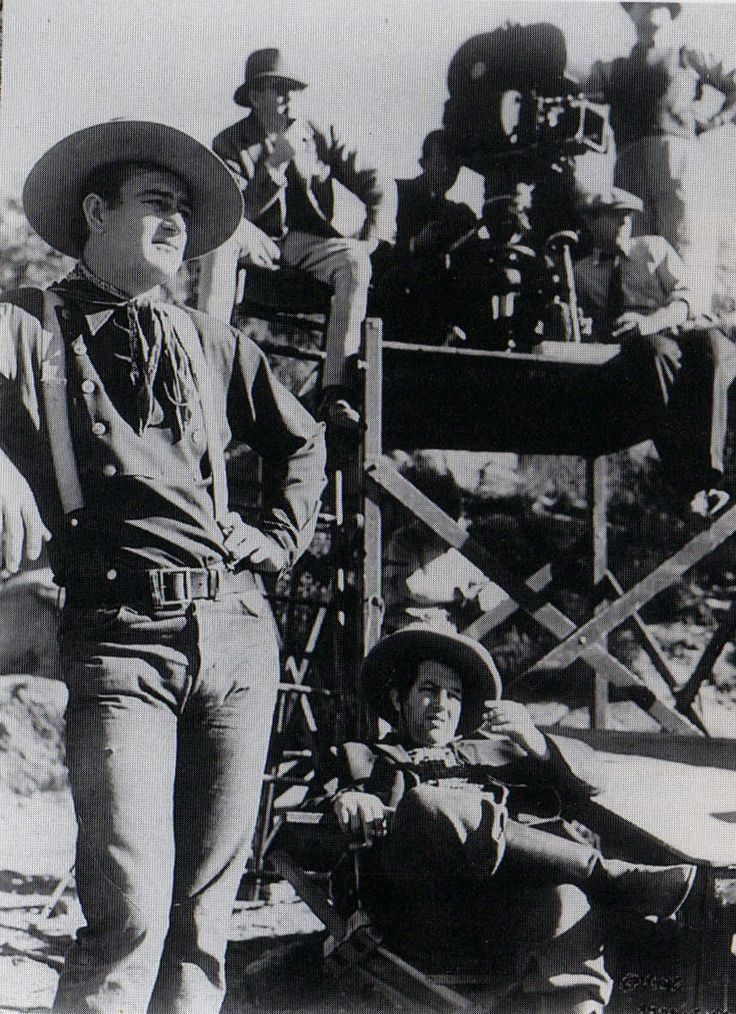"John Wayne, Andy Devine and director John Ford on the set of ""Stagecoach"" (1939)."