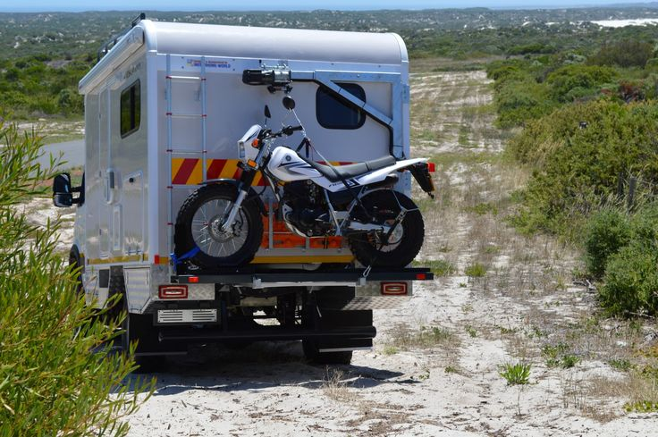 Discoverer Xtreme with rear mounted motorbike.
