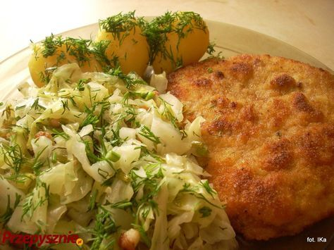 Kotlet schabowy z młodą kapustą i z ziemniakami - Pork chop with young cabbage and potatoes - the most typical Polish dish. The traditional sound in Polish homes on Sunday mornings is the pork chops being pounded out ;)  #Polish_food #Poland #schabowy