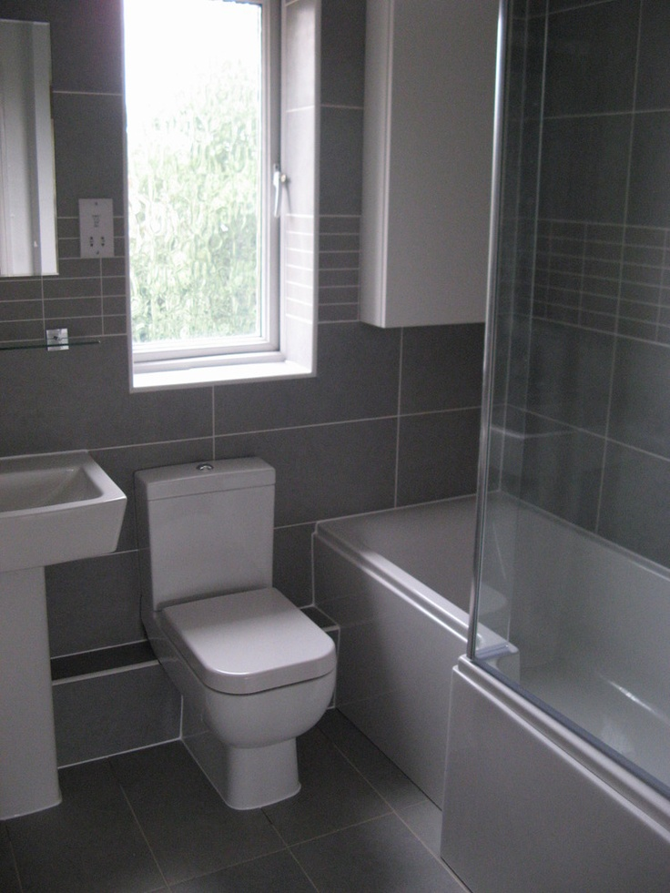 Bathroom installation with greys and whites by RVC Contractors
