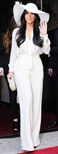 Kim Kardashian Channels Cher with Retro Look- k i might need one of these hats after all for Summer