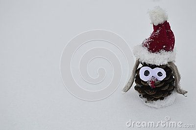 Cute handmade toy from cone for christmas or valenitnes day sits in the snow