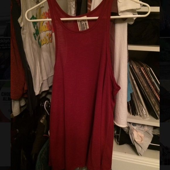 Free people halter tang top Red loose flowy tang top that has a halter shape at the top. Free People Tops Tank Tops