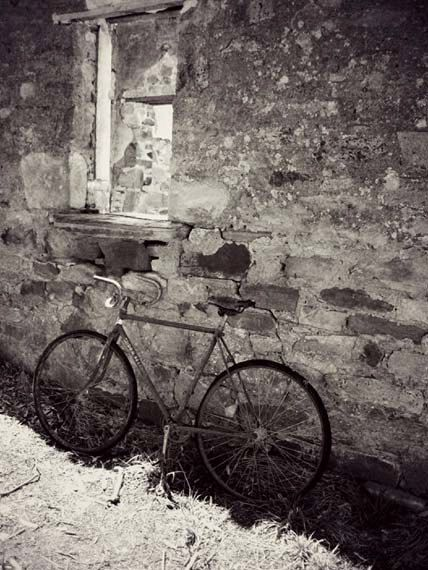Black and white photography, Fine art print of old bicycle leaning against ruins. Ridden Home - Made by Gia from $30.00