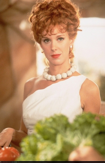 Elizabeth Perkins as Wilma Flinstone