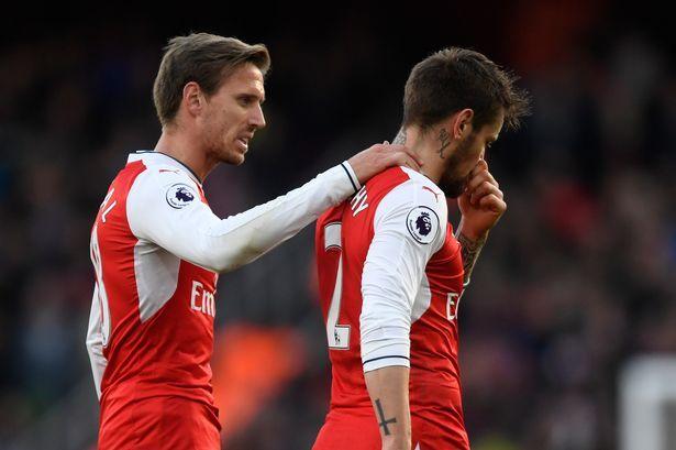 Arsenal's Mathieu Debuchy goes off injured