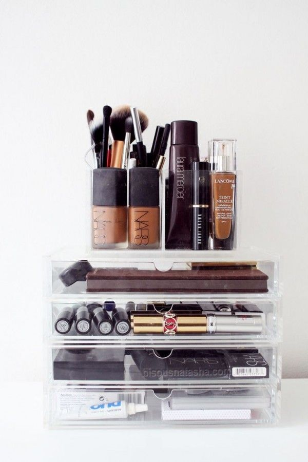 Organizing makeup using lucite drawers is both pretty and functional.