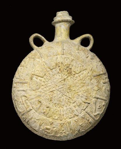 AN UNGLAZED AYYUBID PILGRIM FLASK, SYRIA OR POSSIBLY IRAN, 12TH CENTURY