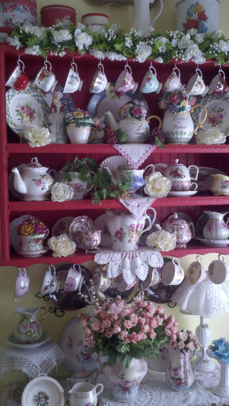 Red Cupboard. Such  a pretty china display.