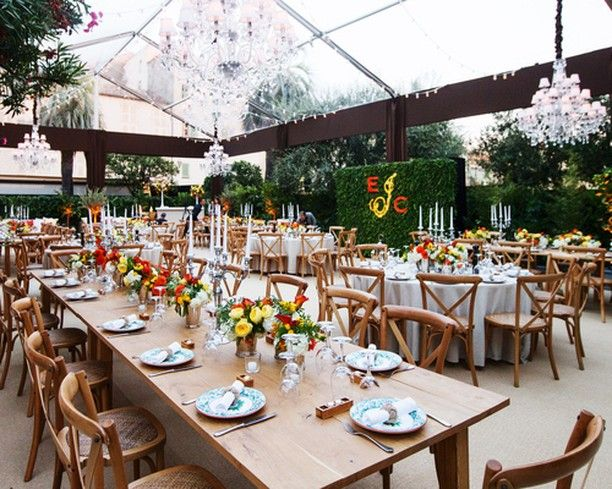 Magic & Cookie Johnson hosted their family and friends at the world famous Michelangelo's restaurant in Antibes France to celebrate his 25th wedding anniversary with a delicious family style dinner and dancing! Bright pops of yellow and orange highlighted the rustic Italian decor and made for one amazing party! (Photo by @kevinweinstein) #eventproduction #eventdesign #france #specialevents #destinationeventplanning