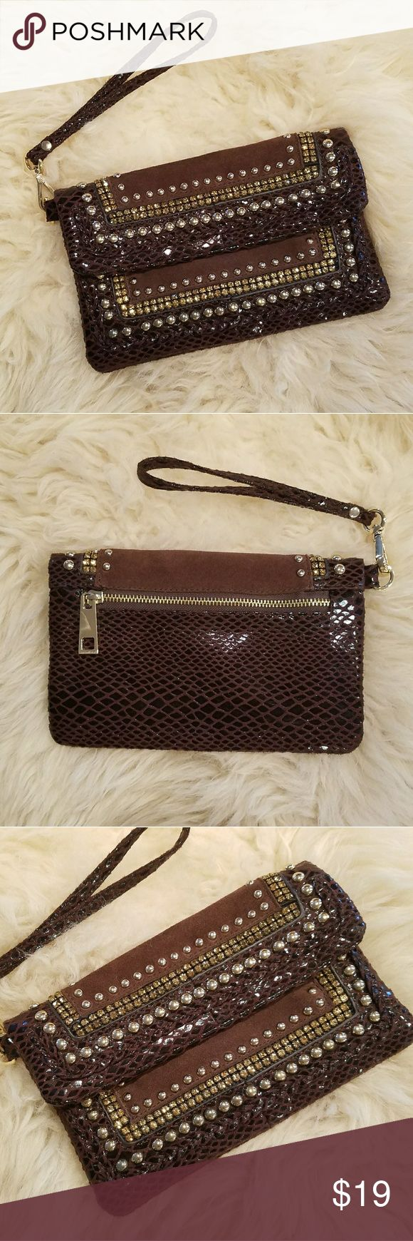 "Cache Studded Clutch Wristlet Brown & Gold Beautiful small brown faux snakeskin and suede clutch with gold hardware, stud accents and rhinestones. Hidden magnetic closure. 4 card slots on inside zipped compartment. Wrist Strap is removable. Hardly used. Excellent condition.  Offers welcome 💕  Measurements (approx): 8.75"" wide, 6""high. Cache Bags Clutches & Wristlets"