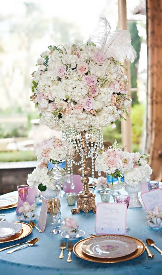 The colors, the small arrangements, the table wear and most of all the crown on the arrangement!!!! Dreamy! I have gold chargers (55 or so if I need more they are from Michaels...use a coupon )-A