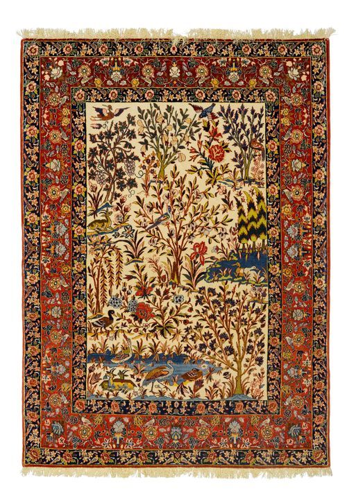 ISFAHAN PICTORIAL CARPET old.  White central field, finely patterned with plants and animals in harmonious colours, red border with trailing flowers, in good condition.  160x220 cm.