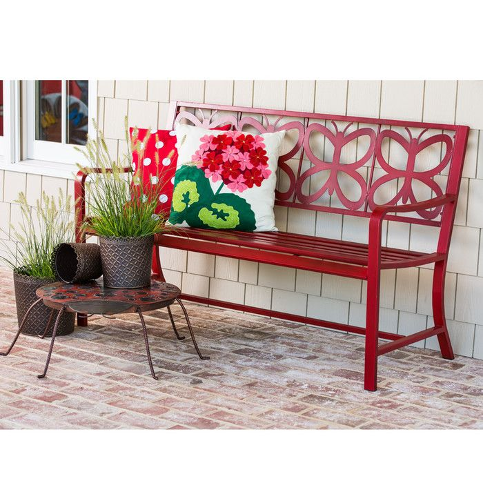 A whimsical twist on an outdoor entertaining staple, this metal garden bench features an openwork butterfly pattern and a bold red finish for eye-catching style.