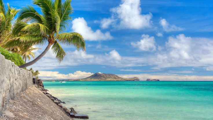 Lanikai Beach, Hawaii world's premier surfing destinations, but the waters of Lanikai Beah on Oahu (the state's third-largest island) are so calm you can kayak over to Mokuluas, two rocky islets on the horizon.
