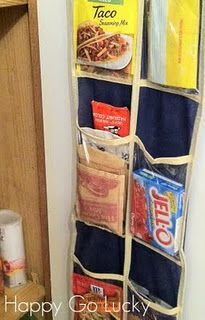 Use a dollar store shoe organizer inside your pantry door to hold loose packets of things like seasonings, gravy mixes and koolaid.  You can also store popcorn, hot chocolate, etc. to throw out the boxes and create more shelf space.