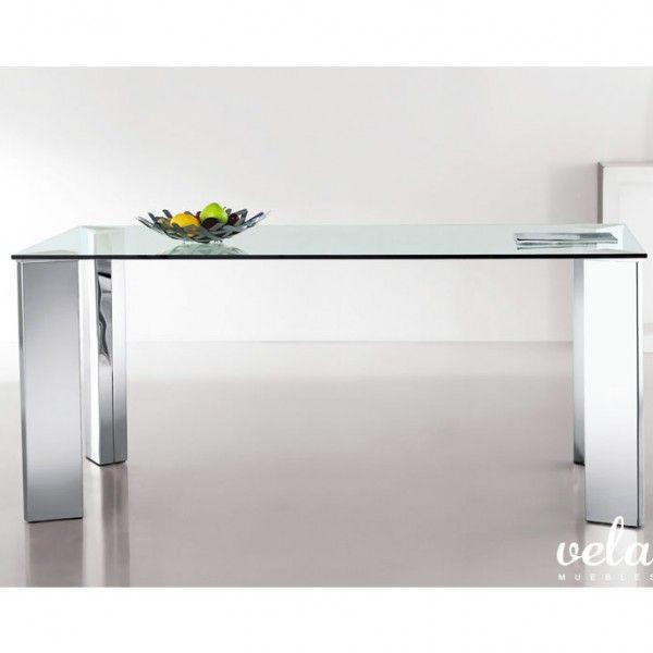 Mesa para comedor fija con patas en acero inoxidable brillante y encimera de cristal transparente templado de 12 mm. Patas en forma triangular.