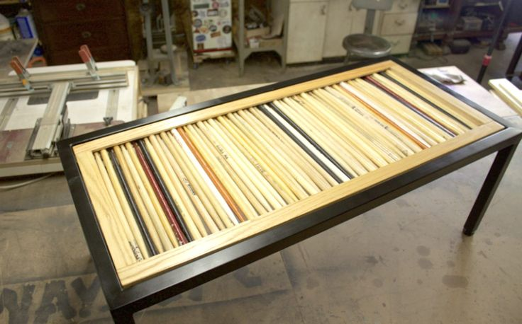"""Drummer Donny Fortin hasn't thrown away a drum stick since middle school, when he played in the marching band. His massive collection of drum sticks—he has buckets of them—has been transformed into quirky coffee tables and side tables, thanks to artist Tim Sway. """"If I can get him to loosen"""
