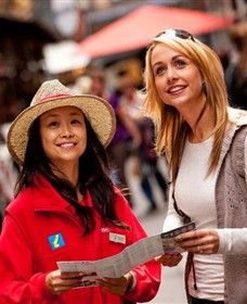 Melbourne City Ambassadors - standing in high traffic corners and stand out with red jacket. Those ambassadors are helping giving tourism and attractions information for visitors _