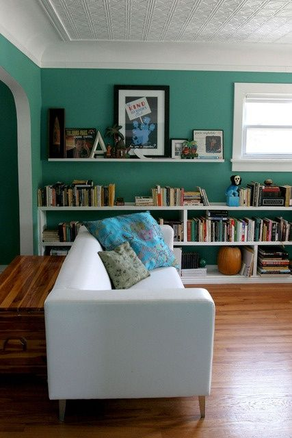 Turquoise walls and place for books