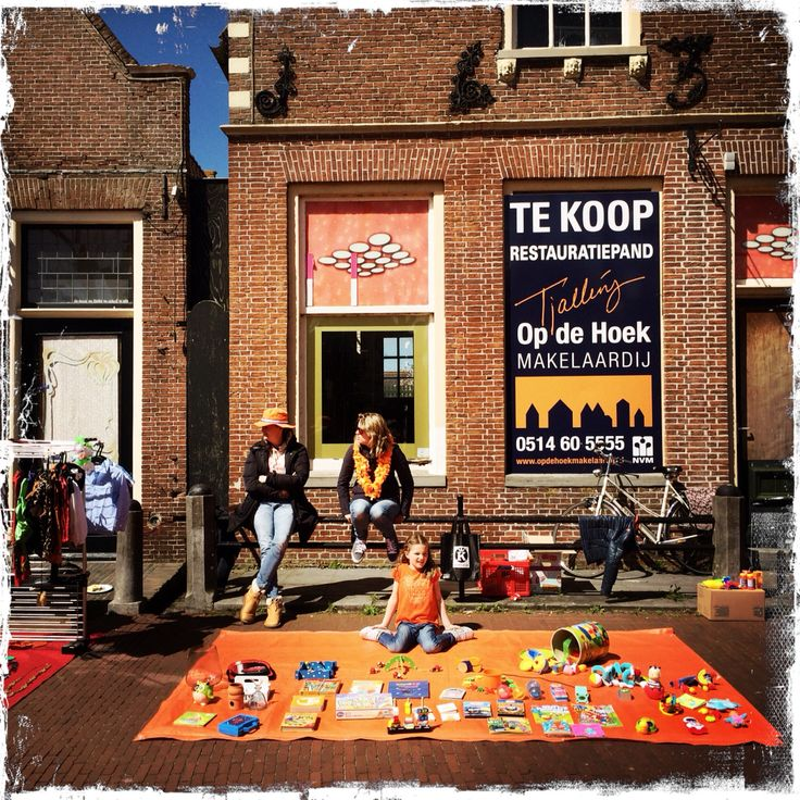 April 27th is King's birthday. Children selling off their toys, books and computer games in fleemarket setting.