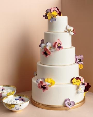 Five-tier cake decorated with hand-painted sugar pansies.