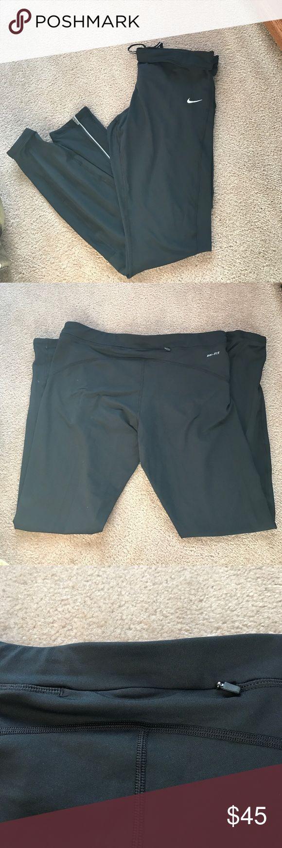 Nike running pants NWOT never worn, black Nike running dry fit pants, bottom of leg has zippers to make leg wider Nike Pants Track Pants & Joggers