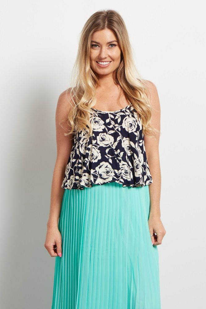 A pretty maternity crop top just in time for the warm weather ahead. This flowy crop top features a gorgeous floral print that looks beautiful paired with any high waisted skirt or shorts. Style this look with your favorite accessories for a complete finish.