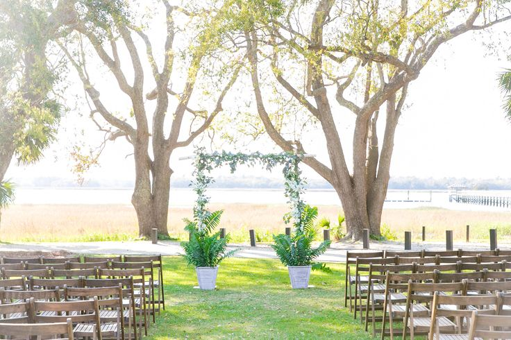 Ashley & Brian's Lowndes Grove Plantation Wedding Ceremony Setup | Charleston, SC | Real Wedding featured on Style Me Pretty | Photo by Dana Cubbage Weddings
