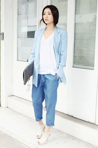 Oversized chambray pieces get a dash of luxe with tall heels, a daytime clutch, and a sleek hairstyle.