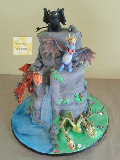 How to train your dragon cake!  3 tier cake. Design includes waterfall, rocks, moss etc. 4 handmade dragons. Toothless, Nightmare, Nadder and Zippleback.