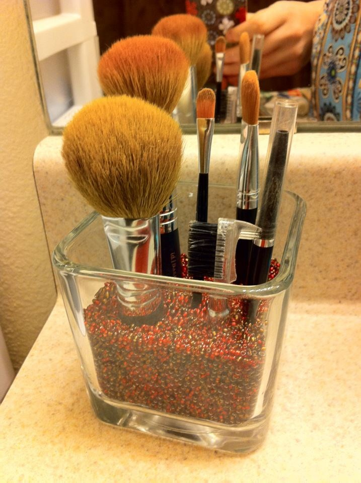 Creative way to store make up brushes! Would also look cool with rocks or small stones!