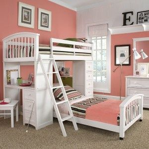 bunk bed option for girls room with a little desk area on the side