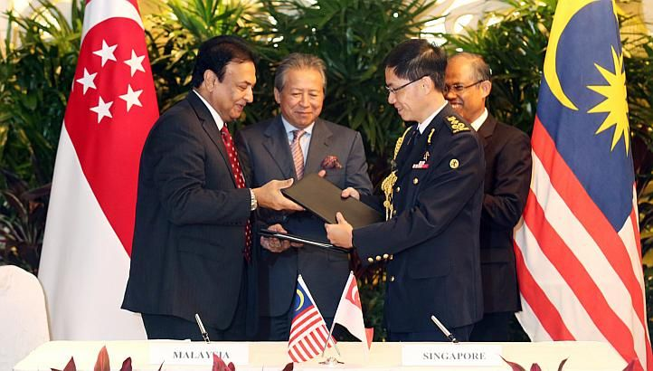 Singapore and Malaysia signed two agreements on Tuesday morning as part of annual bilateral talks.