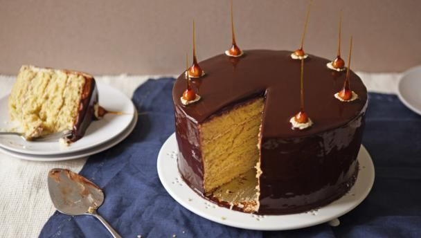Orange-flavoured génoise, covered in a chocolate glaze and layered with a salted caramel cream – I just had to include salted caramel in this recipe as it's one of my favourite fillings.  For this recipe you will need 2 x 20cm/8in springform cake tins, a large heatproof bowl (about 3 litres/5¼ pint capacity), an electric whisk or freestanding mixer, a 20cm/8in cake board, a wire rack that fits in a large baking tray, a sugar thermometer, cocktail sticks, a piping bag fitted with small star…