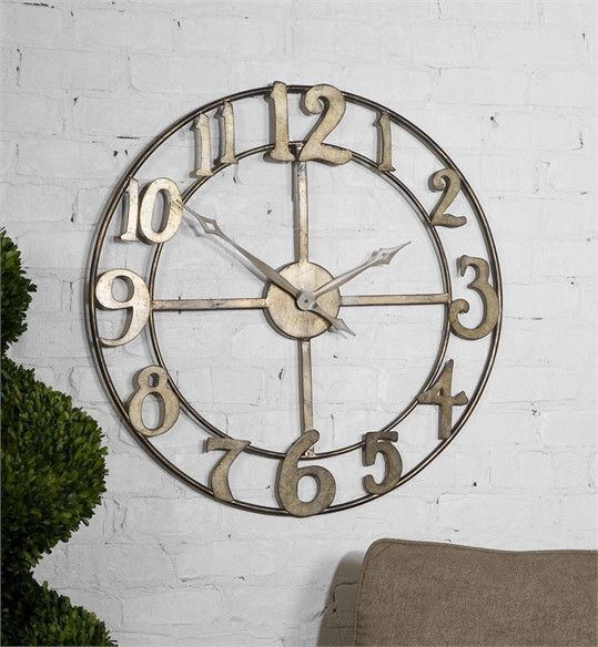 Large Clock. Features An Open Design And Made Of Hand Forged Metal Finished  In Antiqued Silver Leaf With