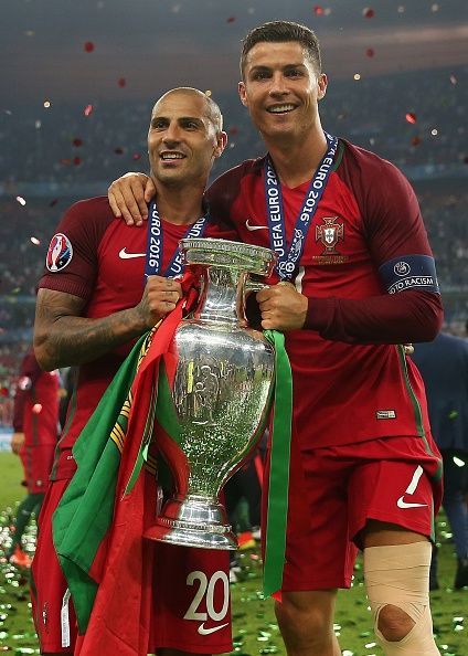 #EURO2016 Cristiano Ronaldo of Portugal poses with the trophy alongside teammate Ricardo Quaresma following the UEFA Euro 2016 Final match between Portugal and...