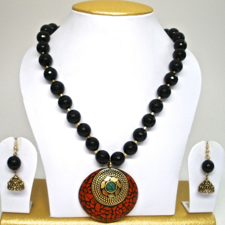 black onyx set with tibetan pendant