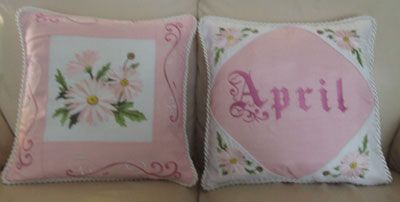 Machine embroidery flower of the month daisy designs on pillows.